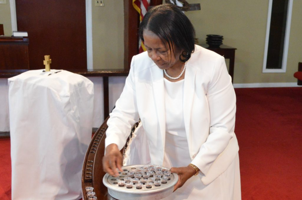 Deaconess setting up communion
